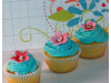 teal-swirl-with-pink-flowers-cupcake